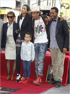Pharrell Williams is honored with a star on the Hollywood Walk of Fame in Hollywood, California | Music producer Pharrell Williams, 41, was honored with a star on the Hollywood Walk of Fame in Hollywood on Thursday. Daytime talk TV guruEllen Degeneres presented Pharrell with his star. Pictured is Pharell, 2nd from right, with his wife, Helen Lasicahn, and son Rocket.