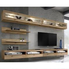 Orren Ellis This entertainment center features high gloss fronts with a matte body and LED lights system. Fronts opened by touch tip-on system and no handles necessary. It is easy to install with pins and eccentric type connections. Living Room Storage, Living Room Tv, Home And Living, Floating Entertainment Center, Living Room Entertainment Center, Entertainment Units, Tv Wall Design, Wood Panel Walls, Wood Wall