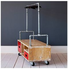 make something like this that you could wheel your stuff in for craft shows and hang your batiks behind your table