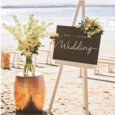 """Blackboard """"Dani & Johnny's #noosawedding #sunshinecoastweddingphotographer #weddingceremony #beachwedding #weddinflowers"""""""