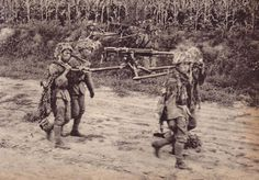 Japanese machine -gunners carryng their weapon in occupied China.