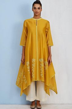 Check out our Mango Yellow Jasmine Kurta by TAIKA BY POONAM BHAGAT available at Ogaan Online store at special price. Taika's summery cotton and organza pieces feature graphic embroideries and appliqués Indian Fashion Trends, Indian Designer Outfits, Ethnic Fashion, Abaya Designs, Kurti Neck Designs, Ethnic Outfits, Indian Outfits, Colourful Outfits, Stylish Dress Designs