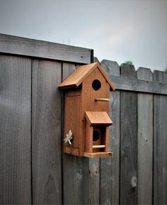 "Beautiful Two story birdhouse made form cedar. *All cedar wood *2 Story *Has vents on both floors *Side comes off for cleaning *Hangs from backside *1.75 inch holes to keep big birds out *Side comes off to remove unwelcome species *14"" tall, 8"" wide, 9"" deep to tip of bird stick"