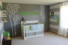 This nursery is cute, clean, and straightforward.  The energy of the bright green is calmed by the gray and touch of blue.   Via : http://projectnursery.com/projects/prestons-place/