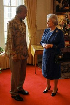 Britain's Queen Elizabeth II with President Nelson Mandela of South Africa during his visit to Windsor Castle before travelling to Cardiff for the beginning of the EU Summit on 11 July 1996