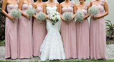Dusky pink bridesmaids dresses and babies breath! Love!