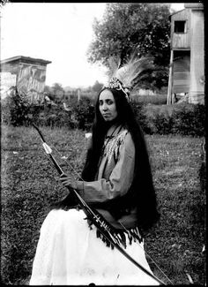 """Iroquois woman: what could she be thinking about the photographer?  Often native peoples were asked to """"dress up"""" for white people for a couple of dollars.  Anything to feed the family!"""