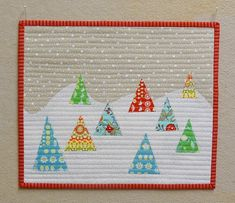 By Cottilello. Love the idea of triangles, such an easy/cute Christmas trees!! Love the quilting idea of just machine stitched lines, too! Not complicated but fancy little quilt!!
