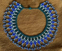 Beaded pectoral necklace by Embera natives Beading Projects, Beading Tutorials, Best Jean Jackets, Beaded Jewelry, Beaded Necklace, Jean Jacket Outfits, Ladies Dress Design, Handmade Necklaces, Seed Beads