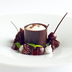 Black Forest cake as a sophisticated gluten-free dessert. Gluten free flour blend, dark Valrhona chocolate and cherries. It's served with a light, minty Chantilly cream and wafers of aerated chocolate. OMG!!!!