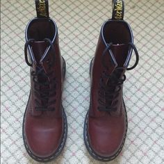 Red Dr. Martins Size 5, dark red. They are in very good condition and only worn a few times. Dr. Martens Shoes