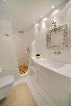Bathroom shower with wooden deck and recessed lights on the ceiling