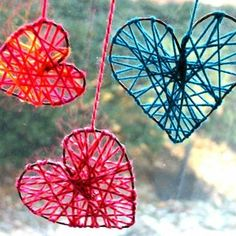 A wire frame wrapped with colored string, hanging in a window will really look great from outside and in ♥