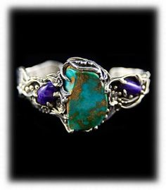 """Blue Gem Turquoise Bracelet with Sugilite.  This awesome women's silver cuff bracelet was made in the """"lost wax"""" style and features a nugget cut natural Blue Gem Turquoise cabochon that is accented by an oval Sugilite cabochon on each side."""