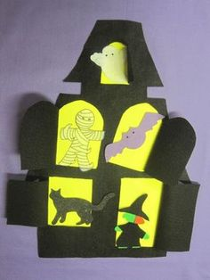 A haunted house filled with a bat, cat, ghost, skeleton, witch and mummy. Windows and a door that open with each verse of the storytime song.