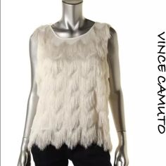 NWT Vince Camuto Ivory Fringe Top, Size Small  NWT Vince Camuto Ivory Fringe Top, Size Small. I'm offering 30% off 2 items or more OR 4/$20 on the red dot items. Also, you can use the red dot items to make my discount of 30% off 2 items or more kick in  Vince Camuto Tops