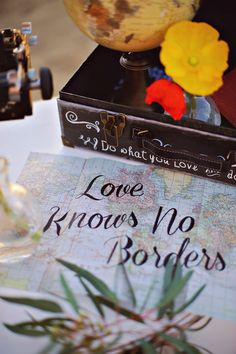 """love knows no borders"" quote map for travel themed wedding."