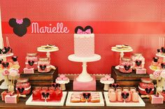 Vintage Minnie Mouse Party via Kara's Party Ideas - some cute details in this party (polkadots, pink & red, etc) - and the cake & cake pops are adorable!