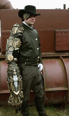 Mechanical Armed Steampunk (man with huge steampunk arm)  - For costume tutorials, clothing guide, fashion inspiration photo gallery, calendar of Steampunk events, & more, visit SteampunkFashionGuide.com