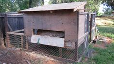 Outside of chicken coop with hinged access to nesting boxes.
