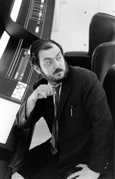 Stanley Kubrick sits on the set for his movie 2001: A Space Odyssey