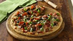 Enjoy this cheesy pizza topped with sausage and olives - perfect for Italian dinner.