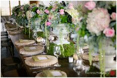 Dramatic pink wedding centerpieces with moss bases