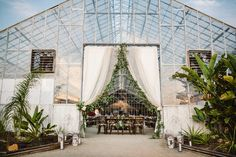 Rustic Greenhouse Wedding on Organic Farm.  Santa Barbara Beach Wedding. Eucalyptus garland, draping, curtains for this beautiful wedding entrance. Photography by Molly Magee.  Design by Tyler Speier Events. Reception Entrance - fabric with eucalyptus garlands and candles and lanterns