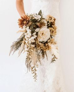 Wedding Bouquet Using silk flowers at your wedding? These are 10 tips you gotta know, and we are not so casually in love with the inspo ideas here too. Exhibit A? This cascading bouquet Bouquet En Cascade, Cascading Wedding Bouquets, Dried Flower Bouquet, Wedding Flower Arrangements, Bridal Flowers, Flower Bouquet Wedding, Floral Wedding, Wedding Dried Flowers, Wedding Flower Bouquets