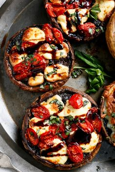 Looking for a low-stress side to dinner? We've got you covered. You need to try these Caprese-stuffed mushrooms on the grill.