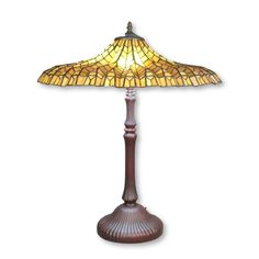 The yellow Tiffany Lotus lamp has a pagoda-shaped blind, this model was invented by Clara Drsicoll. Louis Comfort Tiffany, Applique Art Deco, Lotus Lamp, Blinde, Stained Glass Lamps, Shades Of Yellow, Table Lamp, Bulb, Ceiling Lights