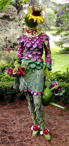 """This life-size mannequin was embellished with faux kale & cabbage leaves and other bits from nature to create this garden sculpture dubbed, """"The Garden Diva"""""""