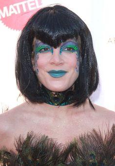 Tori Spellings dark hairstyle with bangs