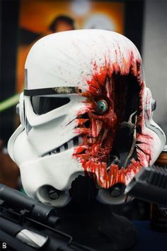 """Bloodied Stormtrooper Helmet at Comic-con. Doesn't really belong on my """"humor"""" board, but it's definitely geeky!"""