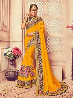 a5d1aec978fda Yellow Art Silk Embroidered Border And Plain Pallu Party Wear Saree With Unstitched  Blouse Hand Work