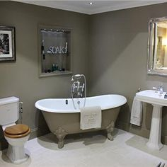Stone & Chrome. The walls and the cast iron bath are painted in Mouse's Back. Farrow and Ball