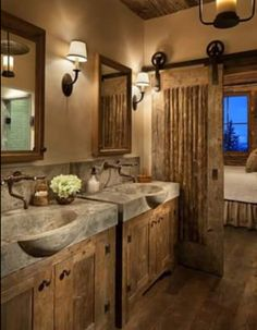 Love this woodsy bathroom. The sinks are amazing.
