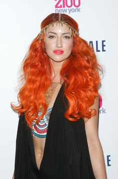 Flame on! Neon Hitch's fiery copper locks have us feeling all hot under the collar.