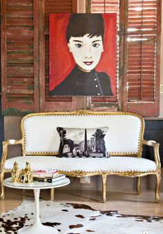 Isn't this settee glamorous in the otherwise industrial-looking space?