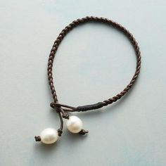 """BROWN BRAID BRACELET - Luminous cultured pearls are the light at the end of dark brown, braided leather. Slip a pearl through the loop to secure the bracelet round the wrist. Handmade Sundance exclusive. 7-1/2""""L."""