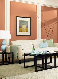 Mentally stimulating, orange is often described as a color that promotes lively conversation. Hitching Post from Pittsburgh paints & Stains is used in this modern living space.