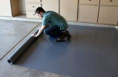How to Choose Garage Flooring: From tiles to rolls to epoxy, find the right garage flooring for your lifestyle and budget and take you garage and home to the next level! How to Choose Garage Flooring Vinyl Garage Flooring, Garage Floor Paint, Rubber Flooring, Flooring Tiles, Garage House, Garage Shop, Garage Doors, Car Garage, Dream Garage