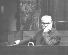 German Field Marshal Hugo Sperrle sitting at the defendants dock during morning recess, Nuremberg, Germany, 1945-1946; Source: United States Army