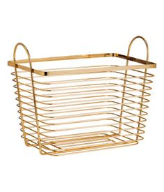 Gold-colored. Large wire basket with two handles at top. Size 6 1/4 x 7 3/4 x 10 1/4 in.