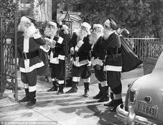 Actor Glenn Ford, left, dressed up as Santa Claus, along with four other actors, for the 1949 film 'Mr Soft Touch'