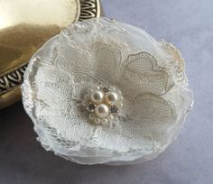 Ivory organza flower with lace, pearls and rhinestones - brooch or bobby pin