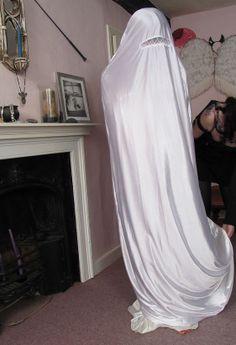 Satin Bondage Burka , with  a drawstring at the bottom   to close  the Burka like a  Sack
