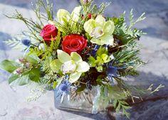Seasonal Vase with evergreens, orchids, roses, thistle, viburnum berries @botanystudio
