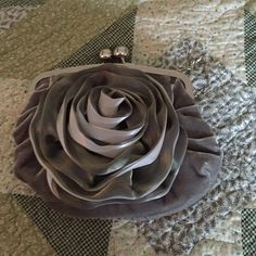 Evening bag This beautiful gray velvet with rose shaped ruffle on front. Is in perfect condition. Great for proms , wedding or dinner out. Stretched out it is 9 inches wide, from top to bottom 7 1/2 inches. It is satin inside, chain is 15 inches( when removed )You will just love it. Not known  Bags Clutches & Wristlets