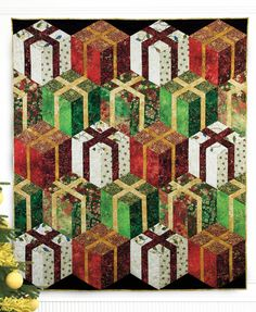 """Stacked Presents"" by Patti Carey (from The Quilter Quilting for Christmas Holiday 2012 issue)"